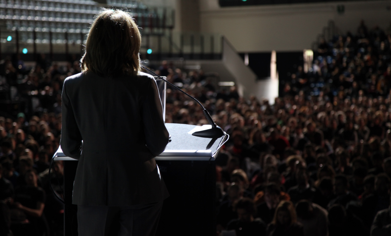 Business Woman Standing To Speaking And Presentation On Podium ...